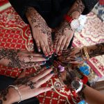 Yemeni girls show their hands decorated with traditional henna designs in the Yemeni capital, Sanaa, on July 29, 2014 as they celebrate Eid al-Fitr, which marks the end of the Muslim fasting month of Ramadan. During Ramadan, observant Muslims do not drink, eat or have sexual relations between dawn and nightfall. AFP PHOTO / MOHAMMED HUWAIS